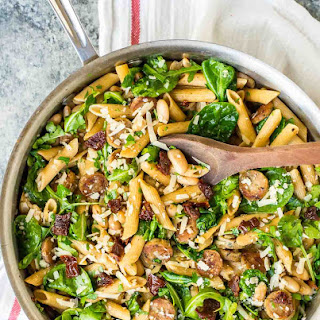 Cheesy Sun Dried Tomato Pasta with Sausage and Spinach