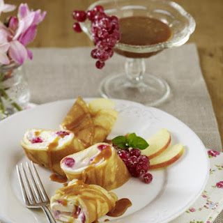 Cheese and Fruit Blintzes with Caramel Sauce.
