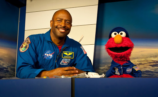 Former Astronaut Leland Melvin speaks with Elmo