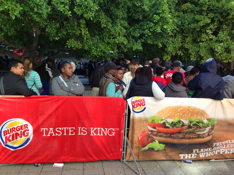 Customers queue outside South Africa's first Burger King outlet, in Cape Town, on Thursday. Picture: PAUL VECCHIATTO