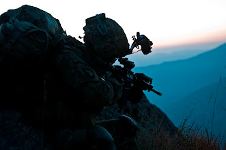 Photo: KUNAR PROVINCE, Afghanistan – As the sun begins to rise, U.S. Army Capt. Sean T. Hinrichs, an infantry platoon leader from East Moriches, N.Y., assigned to Company B, 1st Battalion, 327th Infantry Regiment, Task Force Bulldog, scans the Pech River Valley for insurgent movement in eastern Afghanistan's Kunar Province Nov. 23. Hinrichs was a former U.S. Naval officer. (Photo by U.S. Army Staff Sgt. Mark Burrell, Task Force Bastogne Public Affairs)