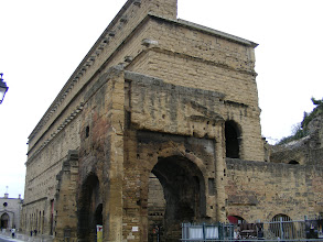 Photo: Here, the exterior view of the main stage wall, which Louis XIV called the finest wall in his kingdom. The Roman Theater was closed by Church edict in 391 CE, then abandoned, pillaged by barbarians, used as a Middle Ages defensive post, and became a town refuge during the 16th-century religious wars.