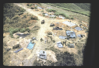 Photo: Bennie Koon picture.  Aerial picture of TOC area on LZ Peanuts.  Appears to be Jim Hackett on radio at 2:00 position and senior NCOs at 11:00.
