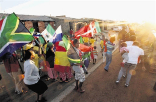 The Soweto resident in Naledi Mojalefa street but up flags outside there house to celebrate world cup .PIC. ELIZABETH SEJAKE. 10/05/2010.© THE TIMES