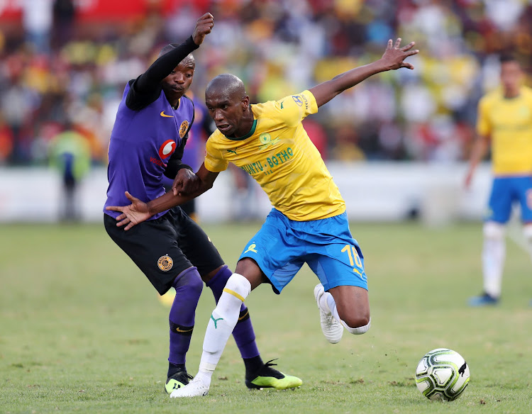 Anele Ngcongca (R) of Mamelodi Sundowns shields the ball away from Khama Billiat (L) of Kaizer Chiefs during the Absa Premiership match at Loftus Versveld Stadium in Pretoria on August 4 2018.