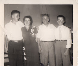 Photo: Fr. Jim with his mother, father, and brother   1952
