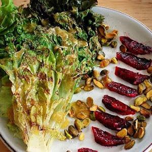 Grilled Red Leaf Lettuce Salad With Blood Orange, Pistachio, and Roasted Garlic Vinaigrette