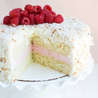 Coconut Cake with Raspberry Buttercream Filling.