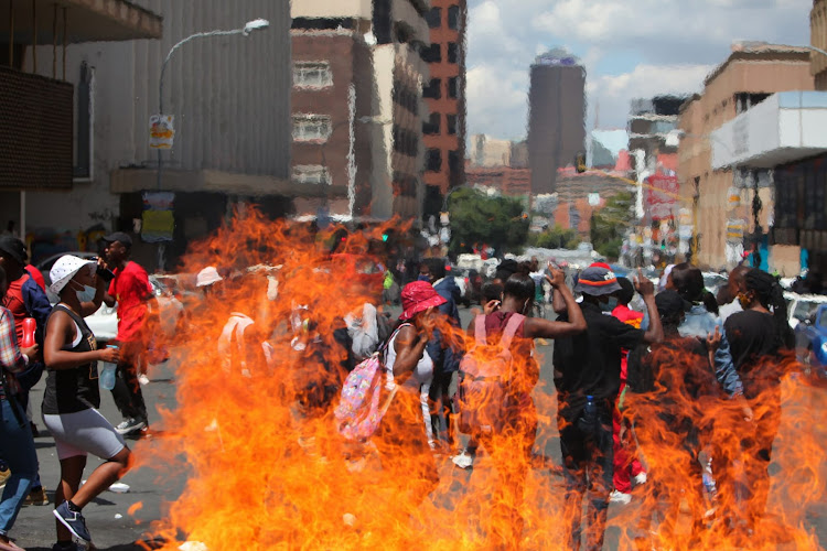 Students close down the streets of Braamfontein as they fight for the clearance of historical debt for students, among other demands.