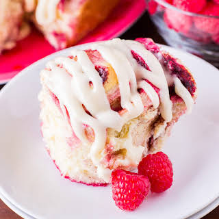 Homemade Raspberry Cinnamon Rolls with Cream Cheese Frosting.