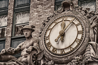 Photo: This is a shot of the clock which sits above the Park Avenue entrance to the Grand Central Terminal area. The clock belongs to the old New York Central Building, now called the Helmsley Building. The final image was created by blending a sepia toned layer with a color layer in Photoshop, using about 75% of the sepia layer. I wanted to have just a hint of color, especially in the hands of the clock.