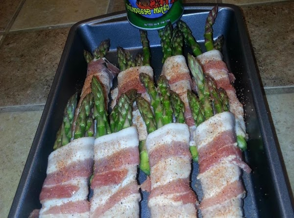 Wrap 1 slice of bacon around several stalks of asparagus (4 or 5) from...