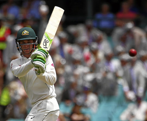 Unique stroke: Australia's Peter Handscomb sends the ball to the boundary on Wednesday in the third Test against Pakistan. Picture: REUTERS