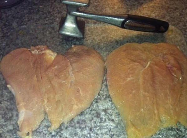 Place a chicken breast d on cutting board. Cut through the center length wise...