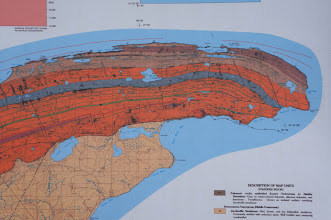 Photo: A map of the Keweenaw, with Lac La Belle in the center. The black line with triangles separating the deep orange and the pale orange areas marks the Keweenaw Fault.