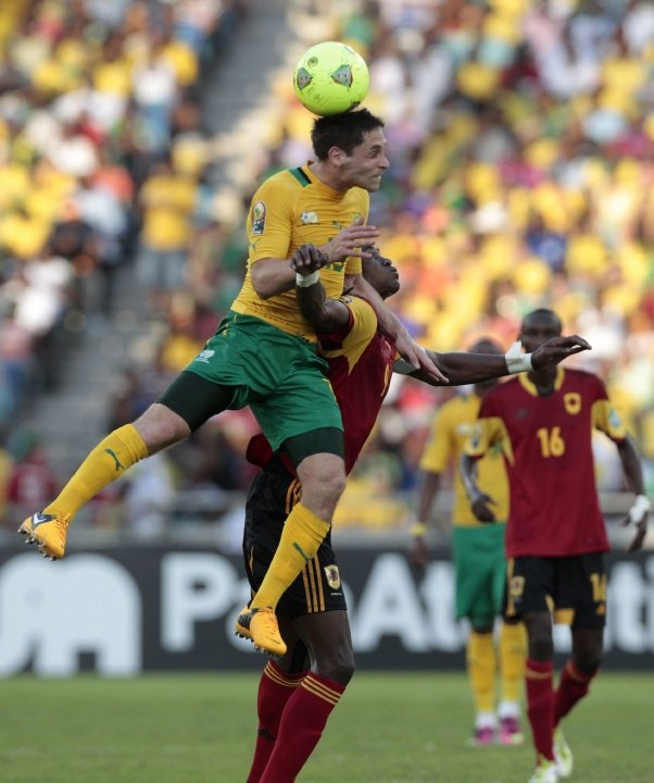 South Africa's Dean Furman jumps for the ball against Angola's Manucho during their African Nations Cup Group A soccer match at the Moses Mabhida stadium in Durban. File Picture: REUTERS