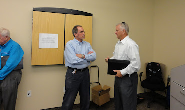 Photo: Volunteer Michael Bush (L) engaged in  individual counseling