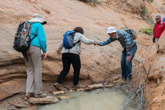 Photo: Doug provides a helping hand; Rim Canyon; PEEC Slot canyons hike with Doug Scott