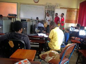 Photo: Student developers seeking guidance from facilitator