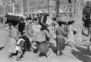 Photo: Photo taken by Robert Capa in Passeig de Gracia, 1939, Barcelona, on 16 January 1939, one day before the city fell to Franco's troops.
