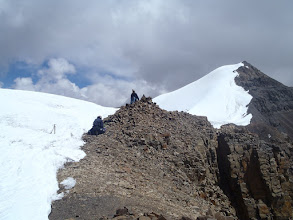 Photo: First summit at 6110m in Purkung Himals. Second summit at 6195m on the back. Andre & Erik resting at 6110m.