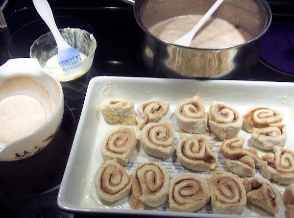 After mixing sugar, cinnamon and cardamon together spread 5 tablespoon across the buttered dough. Now roll...