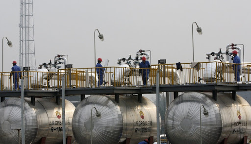 Employees work at a natural gas-purification facility. Picture: REUTERS