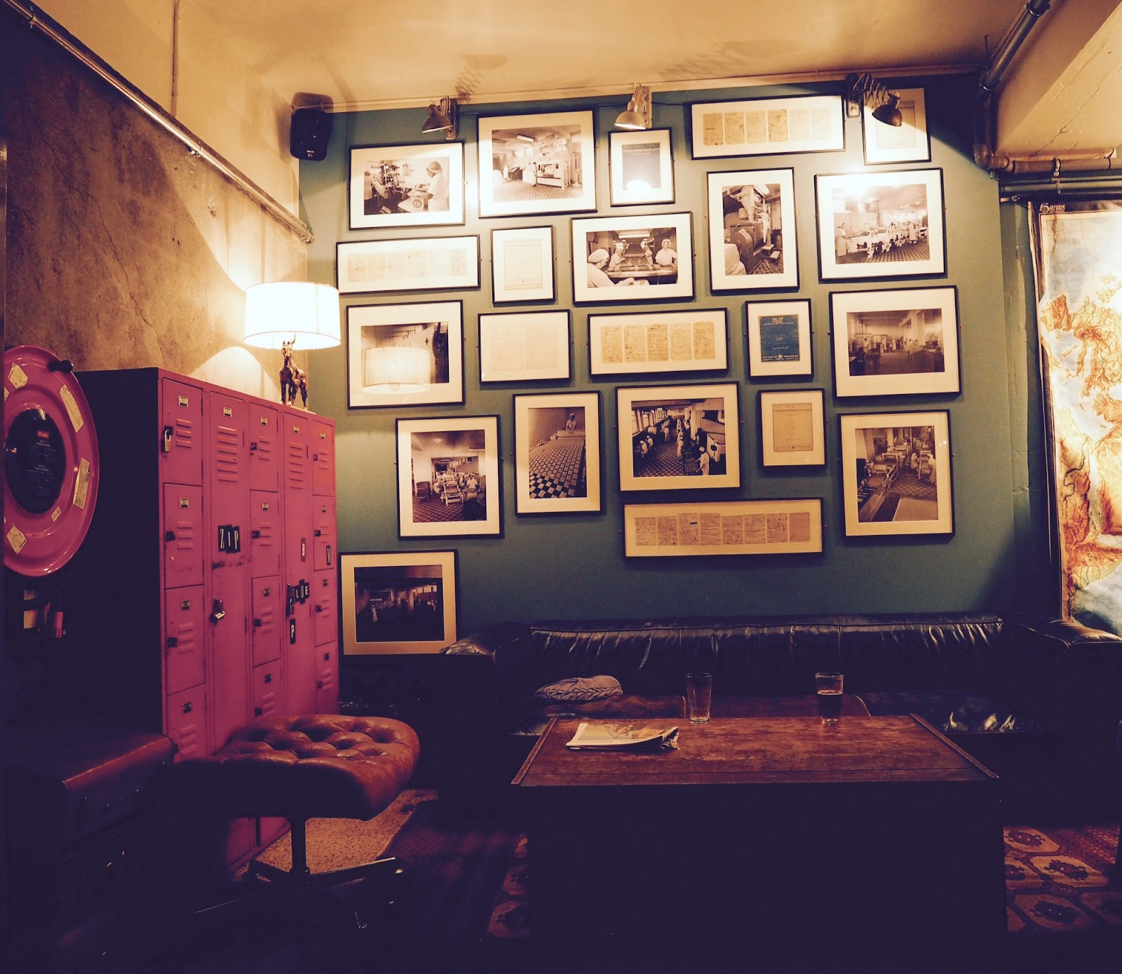 Numerous pictures on a wall at the KEX hostel's reception. Reykjavik, Iceland.