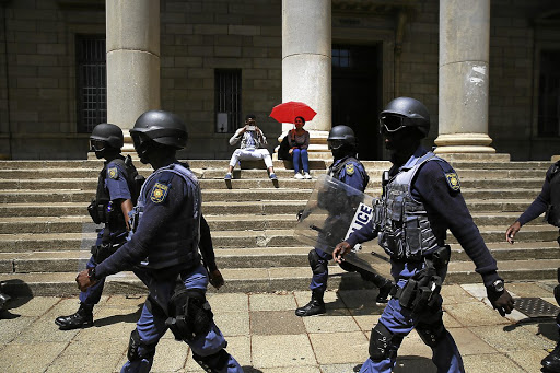 A heavy police contingent patrol the Wits University campus, sometimes firing rubber bullets and a water cannon at groups of protesters. Picture: THE TIMES