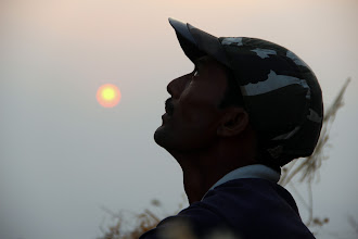 Photo: Guru, waiting anxiously, yet patiently as the sun sets on the team. He ended up staying the night as we descended after dark. (Courtesy Ketan Vaidya)