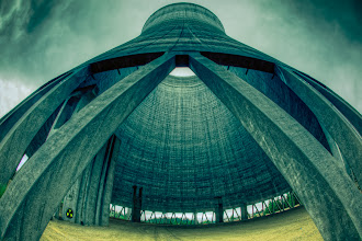 """Photo: On Becoming BFFs With Distortion  It's really hard to put into words just how massive this nuclear cooling tower really is. Unless you've actually had the chance to stand inside of one, words just won't cut it... and images even fall a bit short. The echo that is produced from this concrete cylinder is every bit as amazing as its size and grandeur.  One of my main goals was to figure out how to convey the enormity of this structure in an image. The answer was via distortion and I had just the piece of glass for it - The Funk Buster - aka the Canon EF 15mm f/2.8 Fisheye lens. This lens packs a punch like nobody's business and it did exactly what I hoped it would when I placed it in between two of the main support beams holding up this concrete tube.  The only thing missing was an object to help convey a true sense of scale, but considering the severe amount of distortion already included, I felt it wasn't very necessary. Suffice it to say that those two concrete slabs in the rear center of the chamber were massive in their own respect.  So there you have it - distortion. Something we work so hard to avoid, prevent and mitigate. It's the one thing that truly made this shot special and helped me fit every bit of the cooling chamber into the frame. Maybe it's time you made friends with poor, neglected Distortion, too. :)  A huge thanks again to my man, +Brian Bonham, for making this shoot possible.  Google Maps Location Info 46.95930, -123.47504  In terms of processing This is a seven exposure tone-mapped #HDR image using Photomatix Pro.  Stylization was dominated by Urban Sickness, which contributed to the whole """"nuclear"""" feel of the shot. I also masked in some Tonal Contrast onto the concrete slabs and added some Deep Forest Glow to boost the contrast.  Final touches were applied in Lightroom 4.1."""
