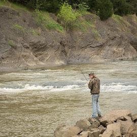 Man Fishing From Rocks by Eva Ryan - People Street & Candids ( hill, oklahoma, male, lake wister, fishing, rocks, man, river,  )