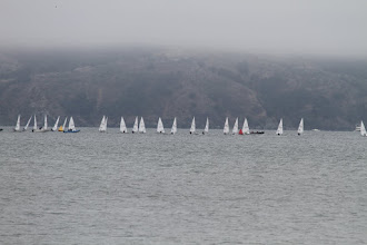 Photo: Good binoculars and keen eyesight are needed to differentiate the sailors across the bay and in the mist.  We send out good thoughts to Jeff and hope he is sailing well and enjoying himself.