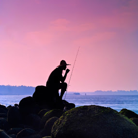 Silhouette of a Fisherman by Ram Suson - People Street & Candids ( punggol beach, pwcsilhouettemotion-dq, silhouette, punggol road end, singapore )