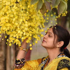 Arti in yellow dress & yellow flower by Basant Malviya - People Portraits of Women ( dress, portraits of women, yellow, arti, flower,  )