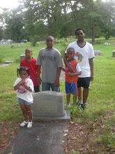 Photo: at the grave of Mama Frances' husband, Curtis