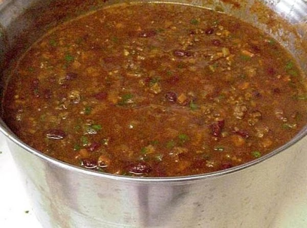 Add the cans of chili, stir, and simmer for about a half hour. ...