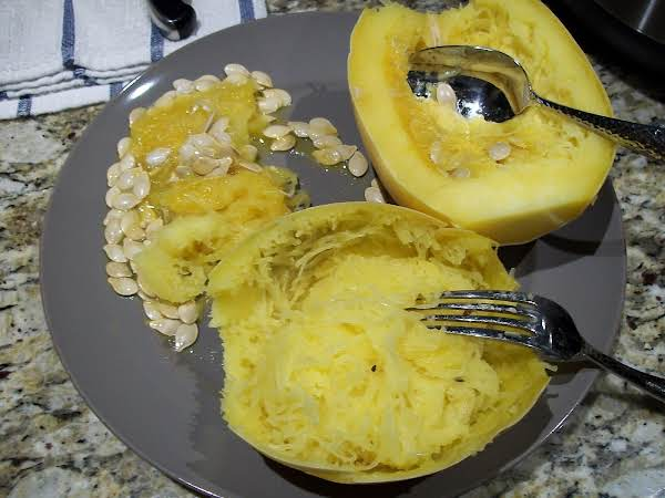 Spaghetti Squash On A Plate With Fork And Spoon.