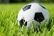 Black and white traditional soccer ball on grass
