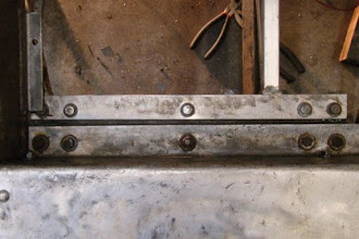 Photo: Photo showing the arrangement of the left-front axle frame mounting bolts.  Photo by Jack Loucks.