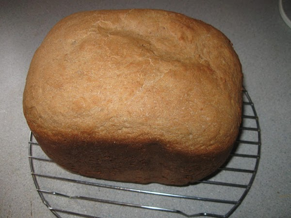 When bread machine is finished, turn loaf out cool on a rack. Do not...