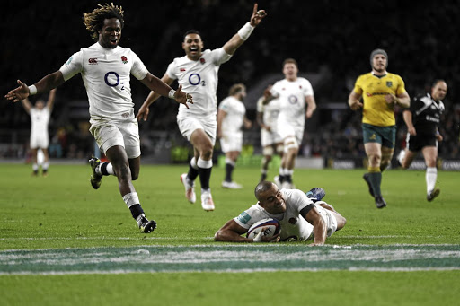 Champions in the making: Jonathan Joseph goes over for England's fourth — and his second — try against Australia. Picture: REUTERS