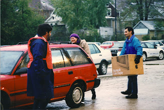 Photo: Loading cars in the rain at a UM Computer Kickoff, Jeff Ogden, Kari Gluski, and ?