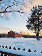 Photo: Beautiful sunset on snow and barn at Carriage Hill Metropark in Dayton, Ohio.