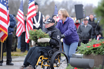 Photo: A former Korean prisoner of war , Duane Broten is assisted by his wife Monica before placing a wreath for the POW/MIA veterans Saturday during the National Remembrance Ceremony at the Minnesota State Veterans Cemetery at Camp Ripley. (Brainerd Dispatch/Steve Kohls) Video and Gallery