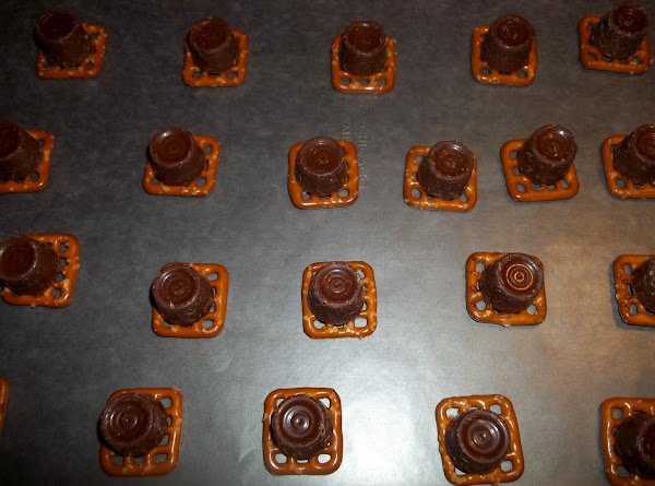 Top each pretzel with a rollo candy.