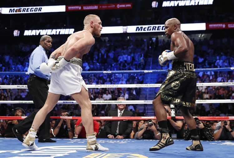 Floyd Mayweather Jr. in action with Conor McGregor on 26 August 2017.