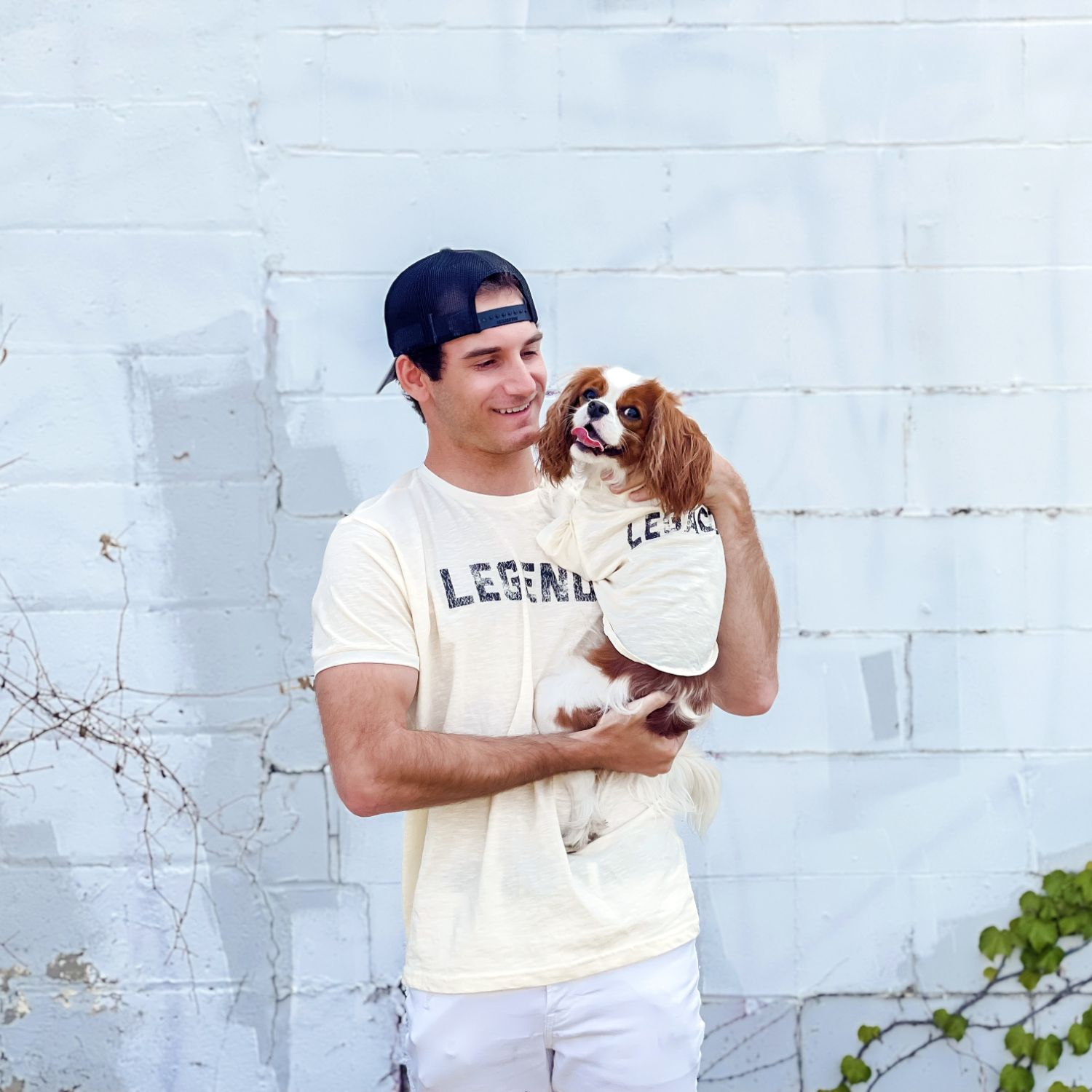 man and dog wear matching tshirts that read legend and legacy