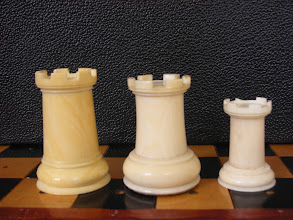 Photo: Comparison of three - non-travel sized  - Cantonese ivory Staunton sets  CH78 - 242 - 302  Rooks  Unlike the travel set versions, the rooks from all three sets have 6 sets of crennelations  (the 'gaps' in the battlements are the 'crenels' from which the term comes, and the protective solid part are the 'merlons' - for those technically minded!)  The respective size of these pieces follows the knights - the largest rook accompanying the smaller king.