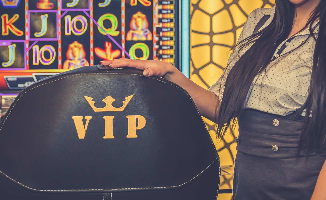 Close up of hostess girl and black golden vip armchair for player inside casino.